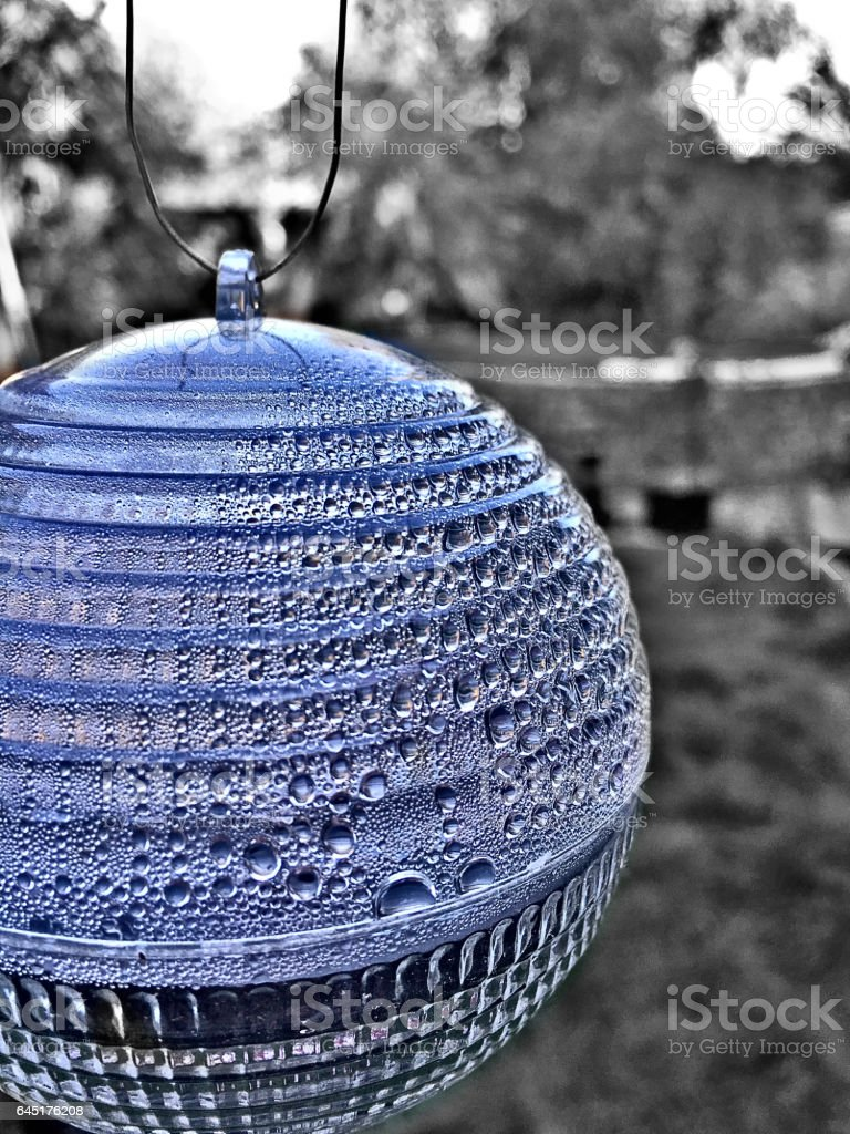 Transparent glass ball with water droplets stock photo