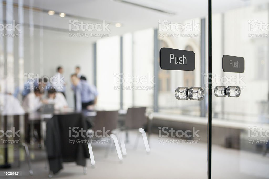 Transparent glass doors leading to office stock photo