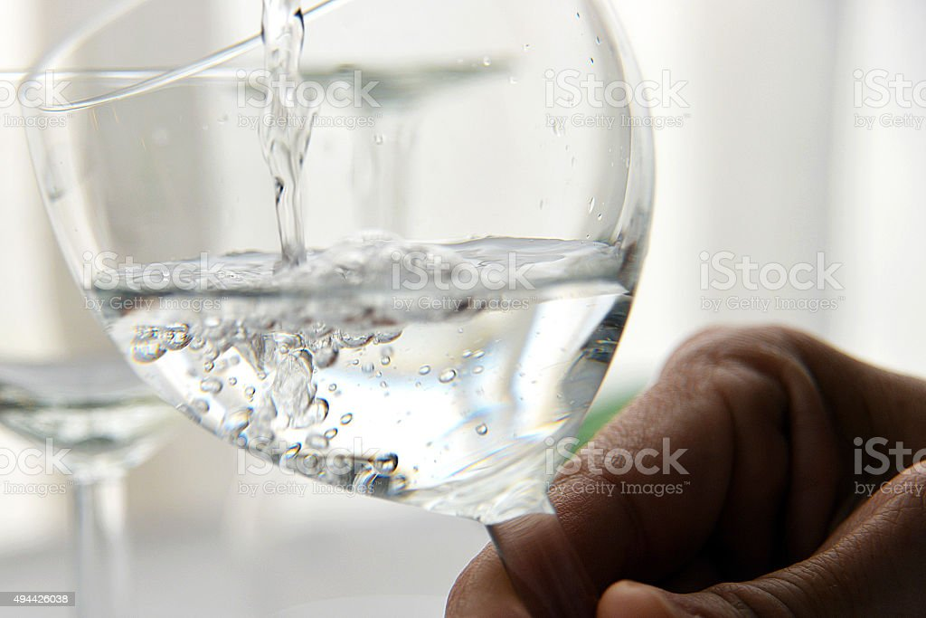 transparent glass filling with water stock photo