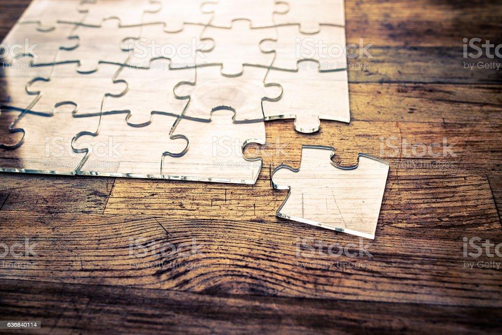 Transparent Jigsaw puzzle on wood background stock photo