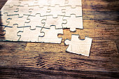 Transparent Jigsaw puzzle on wood background