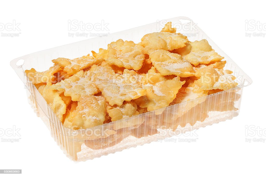 Transparent package of little angel wings, or chiacchiere stock photo