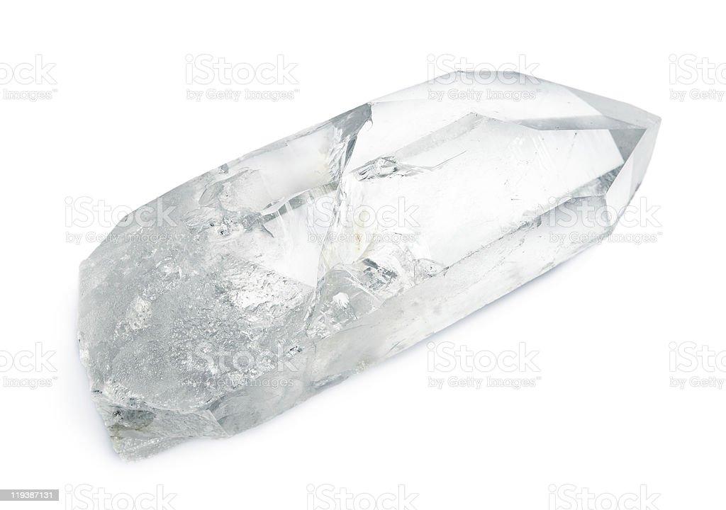 A transparent quartz crystal with a triangular end stock photo