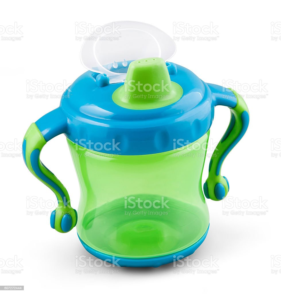 Transparent sip cup, nipple, pacifier botle for water or milk stock photo