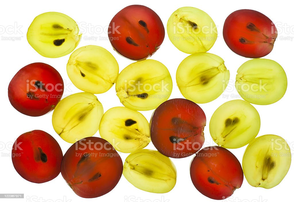 Transparent slices of red yellow grapes stock photo