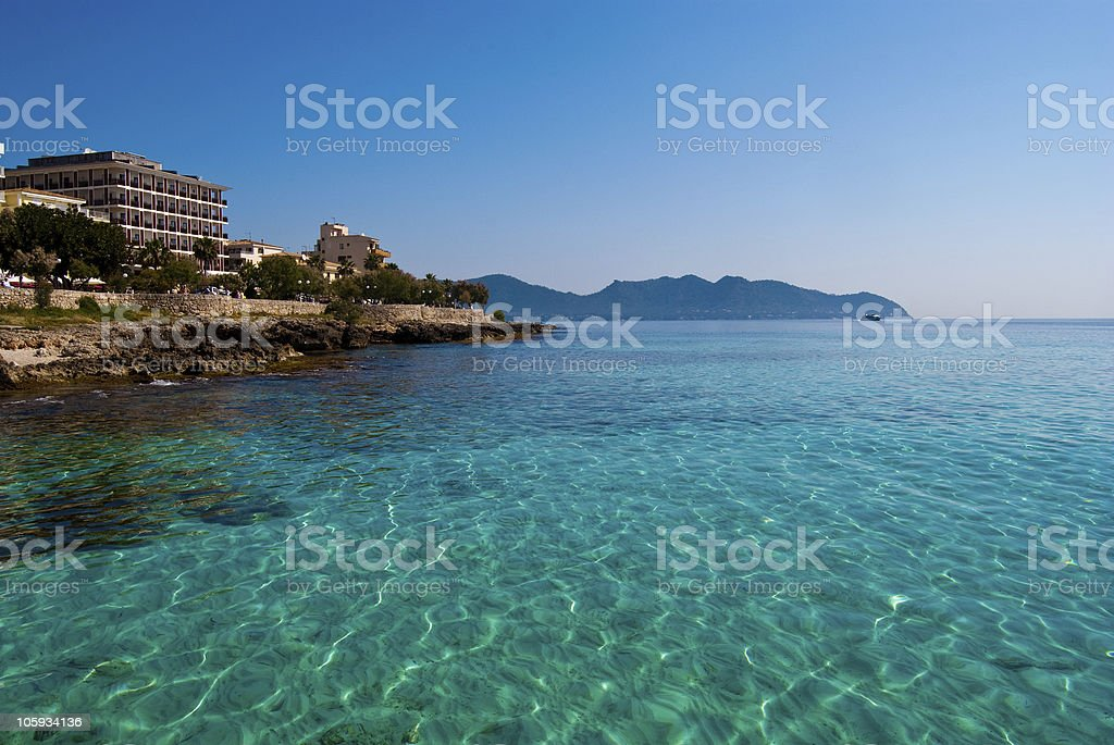 Transparent sunlit water of Mediterranean Sea near Cala Millor, Majorca stock photo