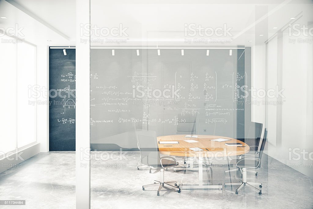 Transparent wall in conference room with furniture and blackbaor stock photo