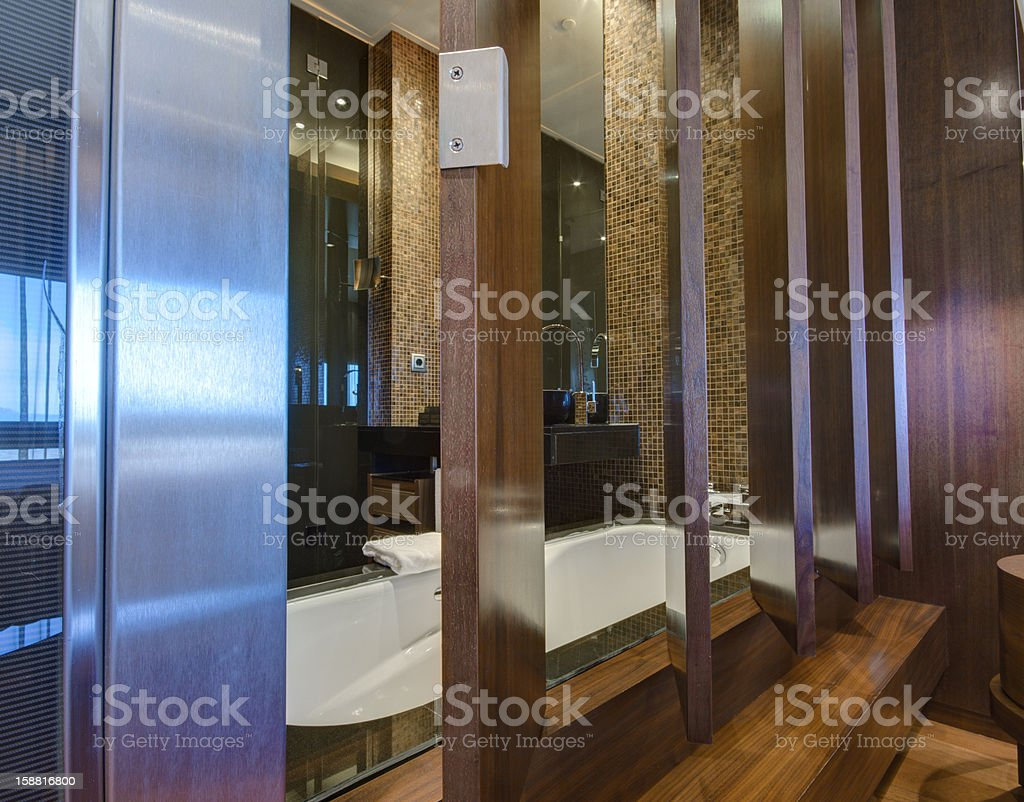 Transparent window between bath-room and living room royalty-free stock photo