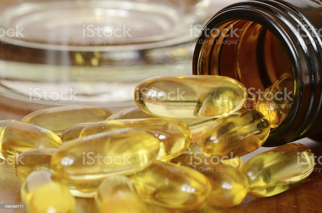 Transparent yellow capsules. royalty-free stock photo