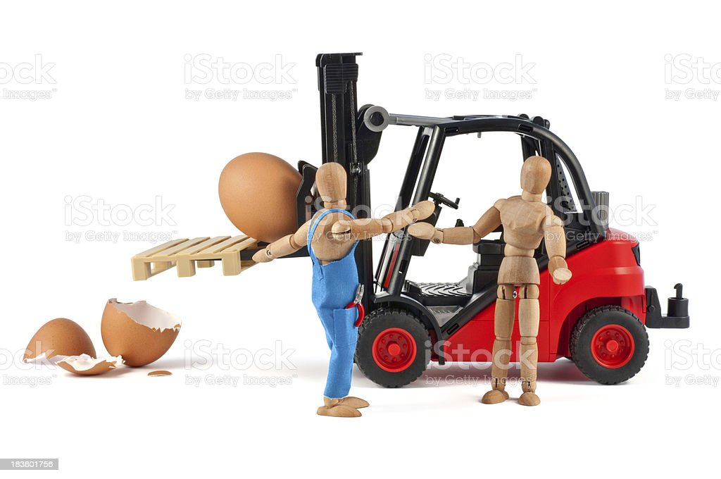 transport damage with forklift - wooden mannequin at work stock photo