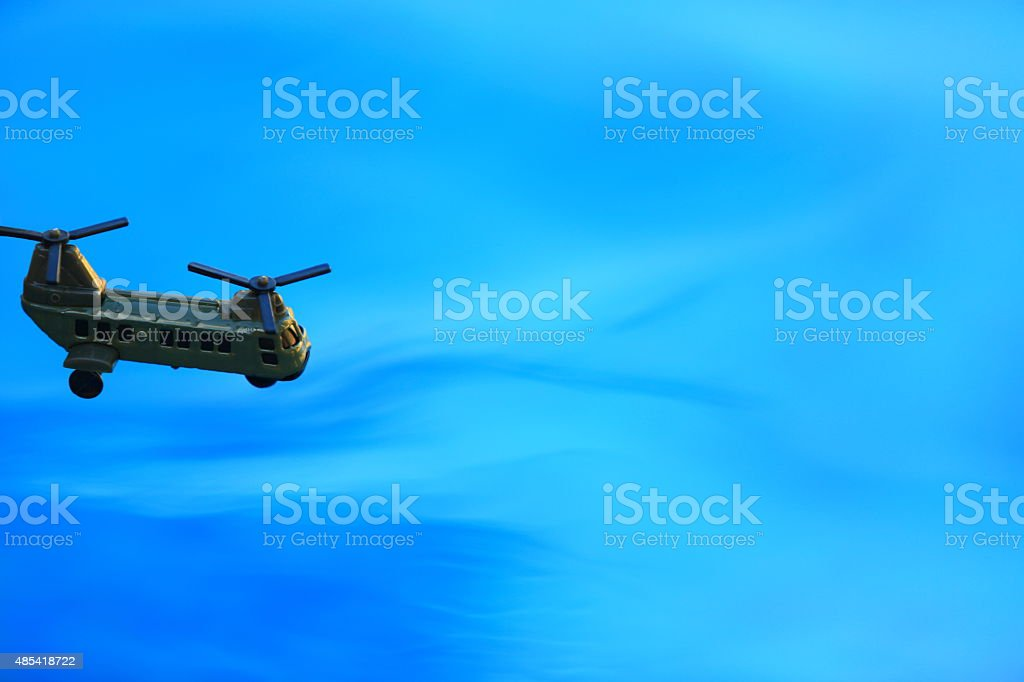 Transport Helicoper Flying over the Sea stock photo