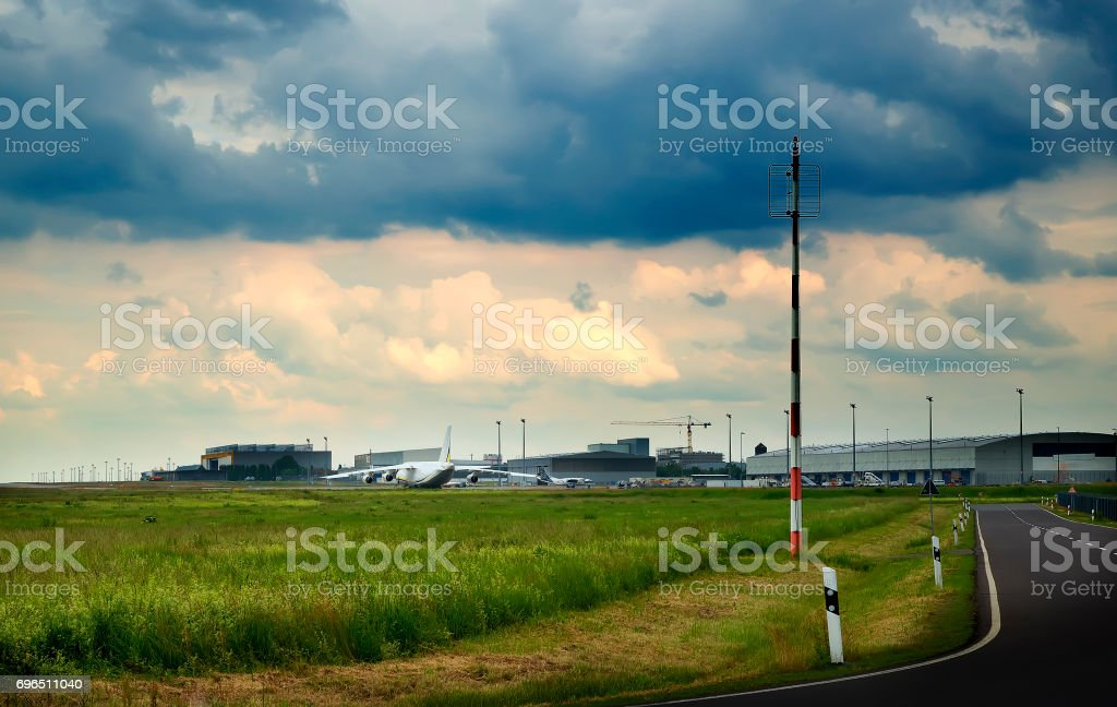 transport plane stands on the runway, in rainy stock photo