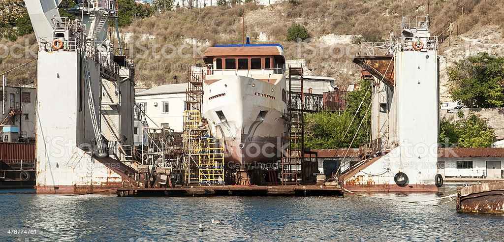Transport ship standing in docks stock photo