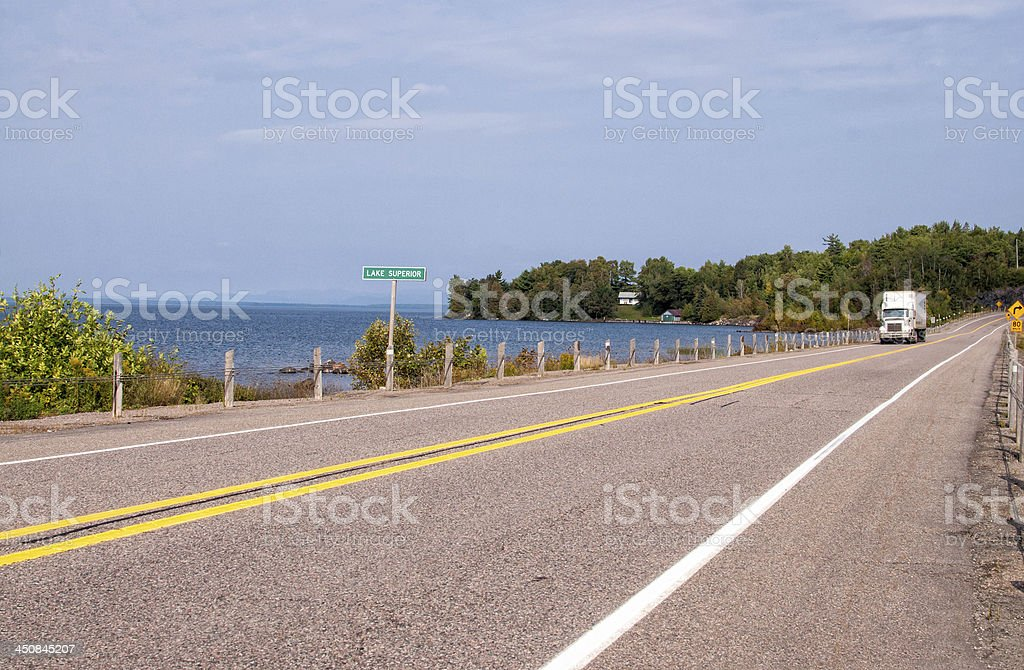 Transport truck on Trans-Canada Highway in northern Ontario stock photo