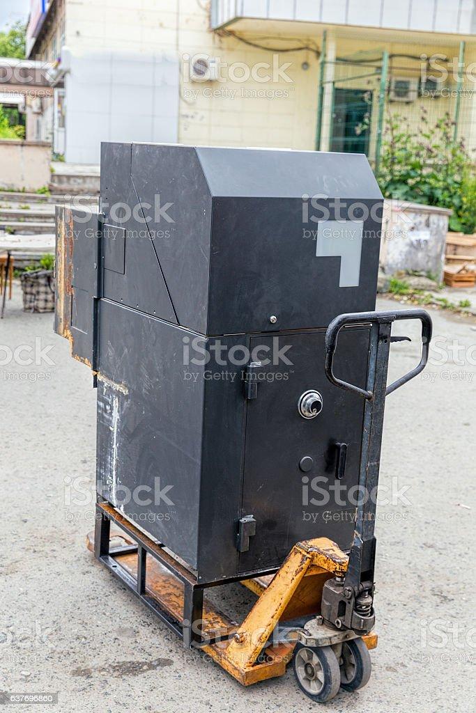 Transportation ATM to manual hydraulic pallet trucks stock photo