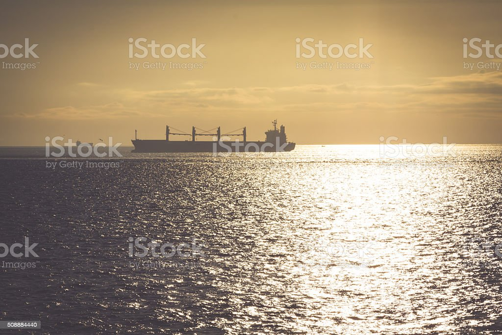 transportation, containers cargo ship out of the harbor stock photo