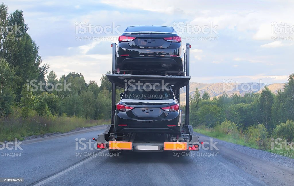 transportation of car on semi-trailer stock photo
