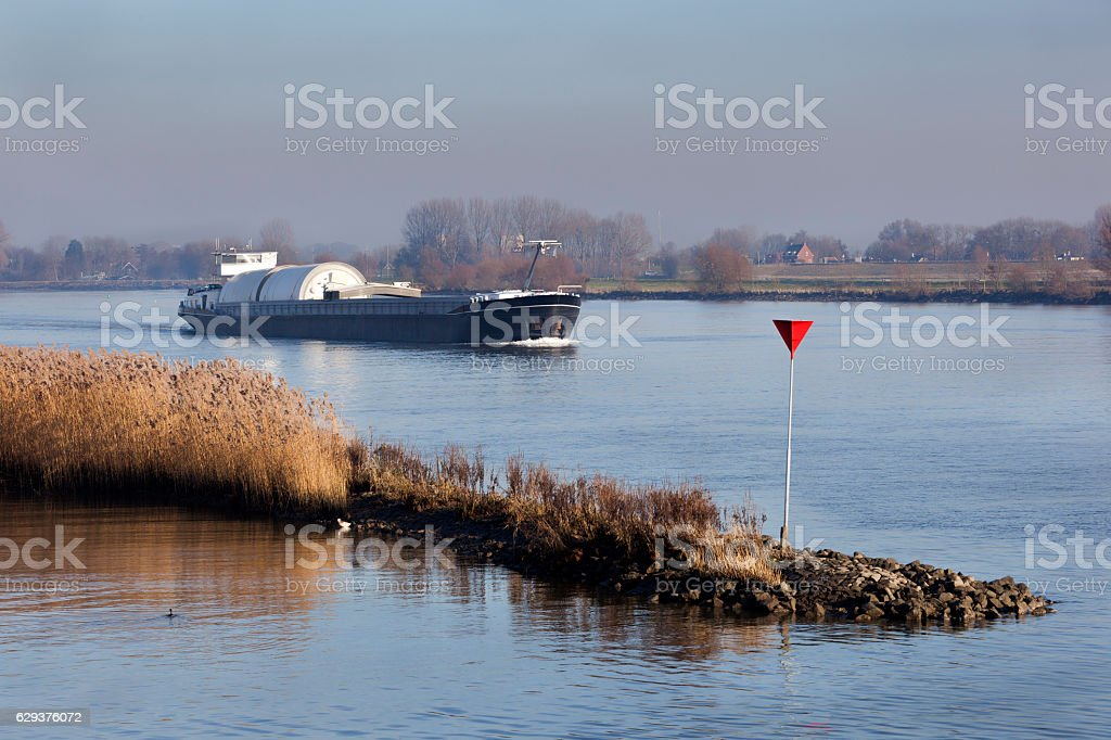 Transportation by barge on the river Lek in the Netherlands