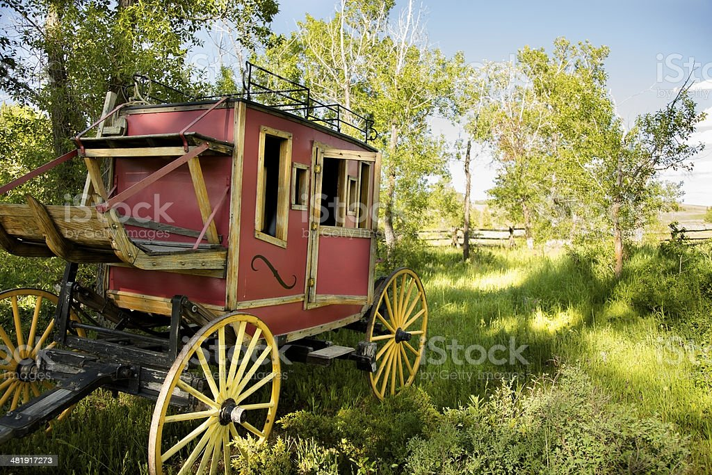 Transportation:  Rustic old stagecoach from the Wild West Days. stock photo