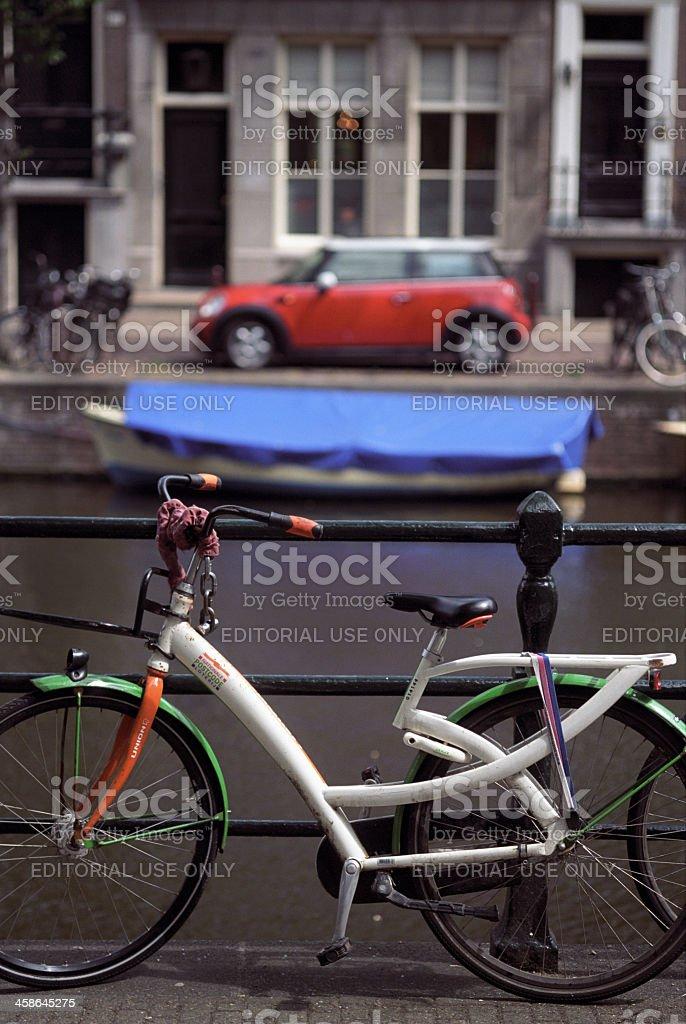 Transportation symphony: bike, boat, car stock photo
