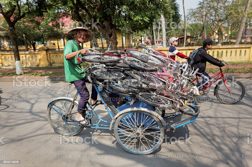 Transporting a load of bikes on a rickshaw stock photo