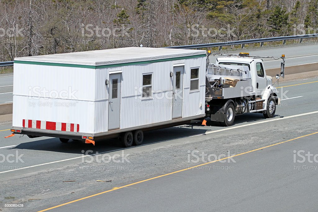 Transporting A Mobile Work Office To A Construction Site stock photo