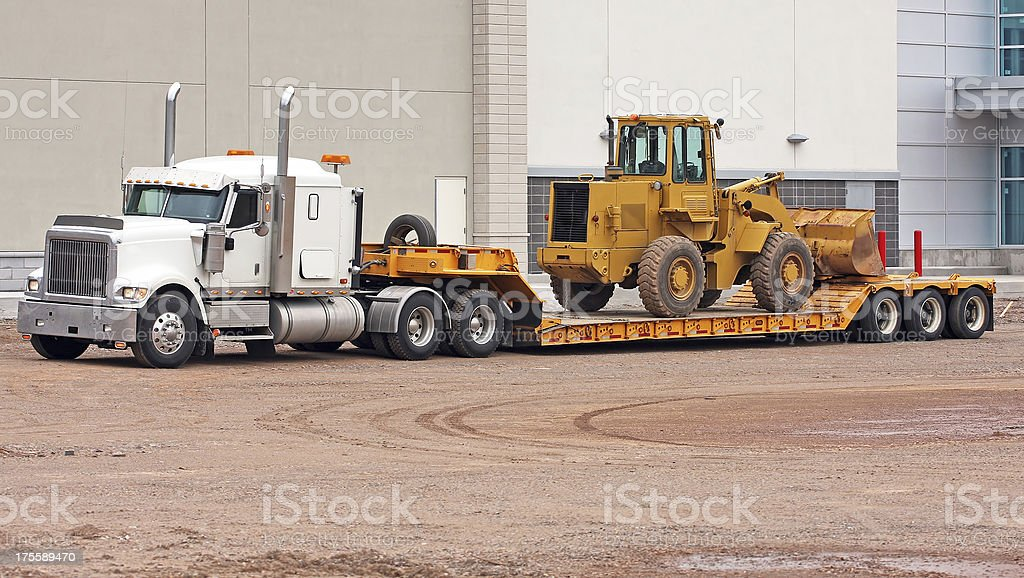 Transporting A Pay Loader stock photo
