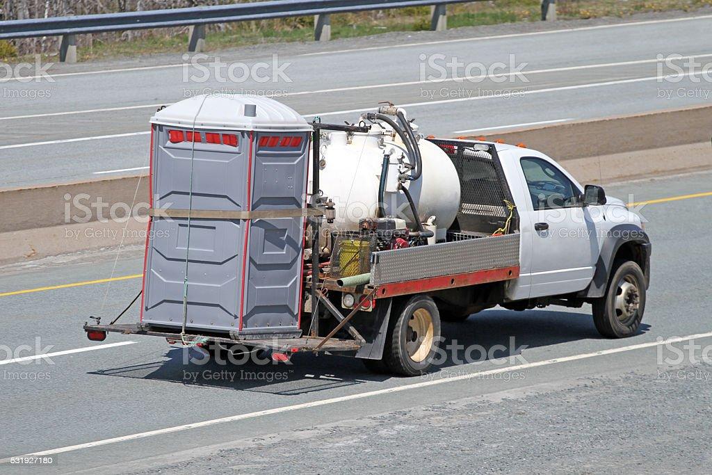 Transporting A Portable Toilet, AKA Porta Potty stock photo