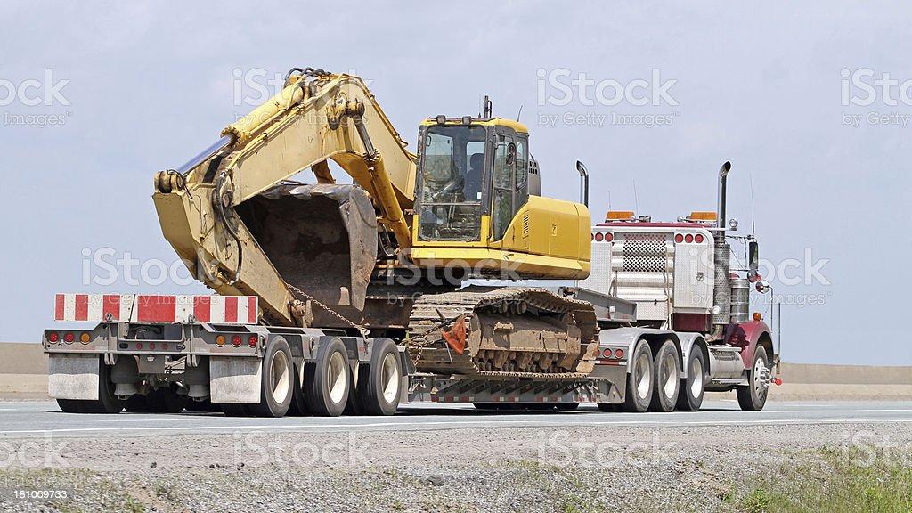 Transporting An Excavator stock photo