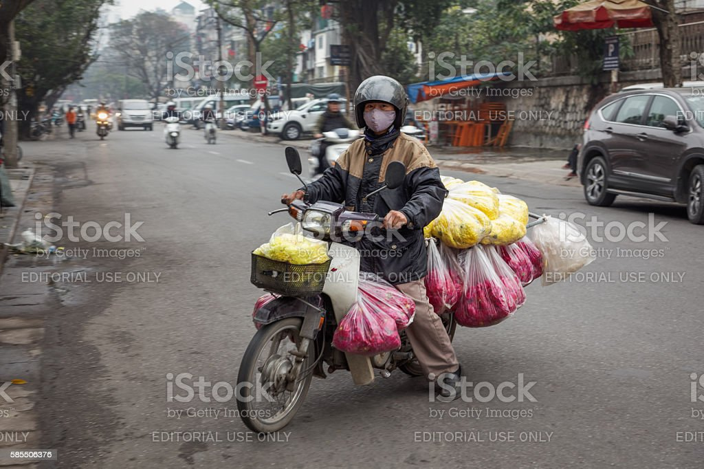 Transporting flowers on a motorbike stock photo
