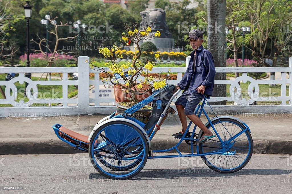 Transporting flowers on a rickshaw stock photo
