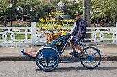 Transporting flowers on a rickshaw