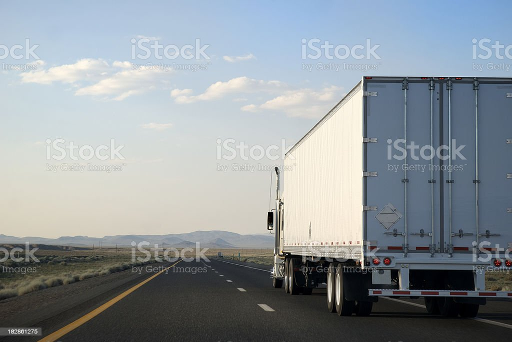 Transporting White Trailer Truck Driving on the Open Road Highway stock photo