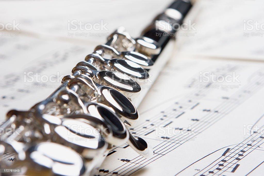 Transverse Flute on Sheet of Music royalty-free stock photo