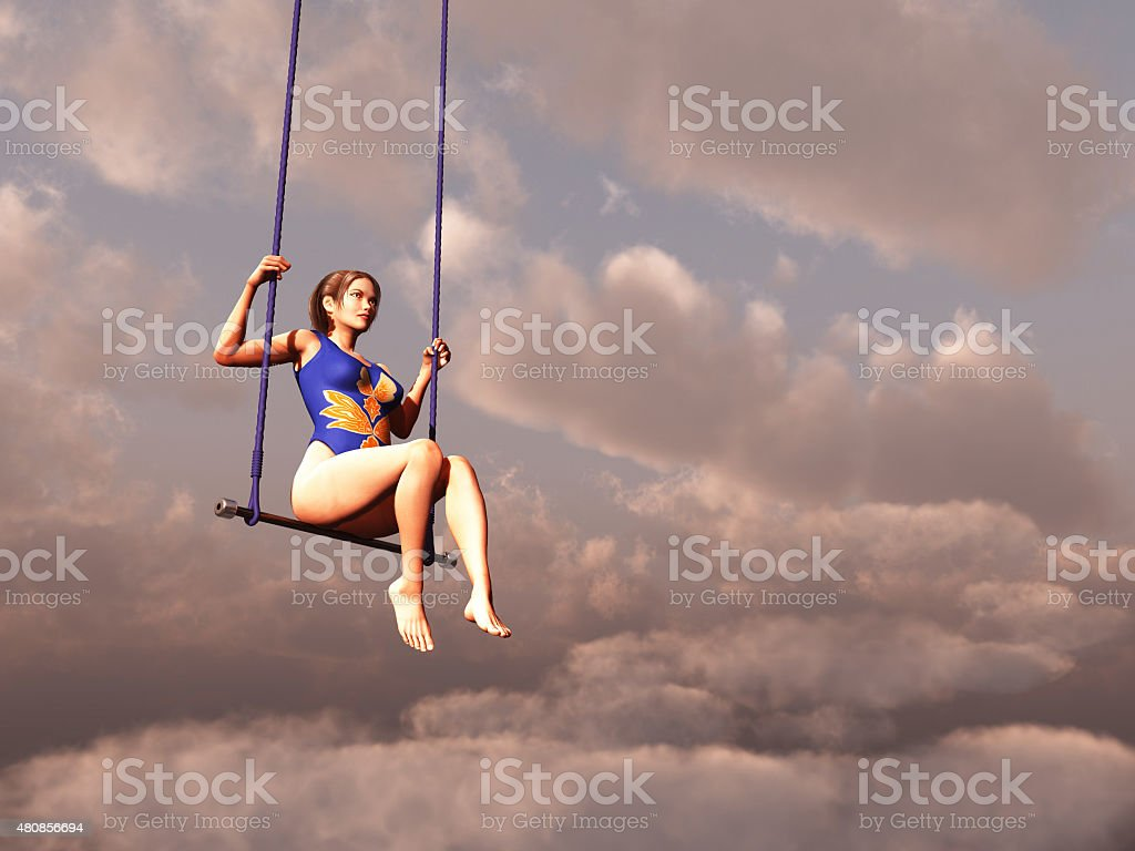 Trapeze woman in the clouds stock photo