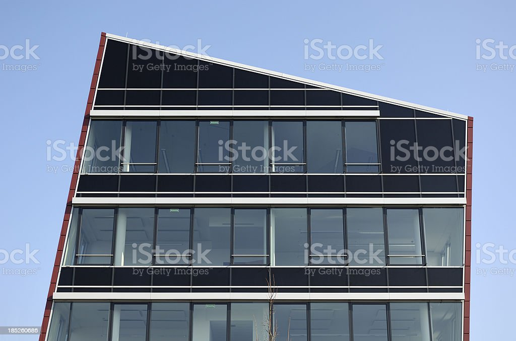 Trapezoidal modern office building stock photo