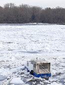Trapped boat into the frozen Danube river in Belgrade, Serbia