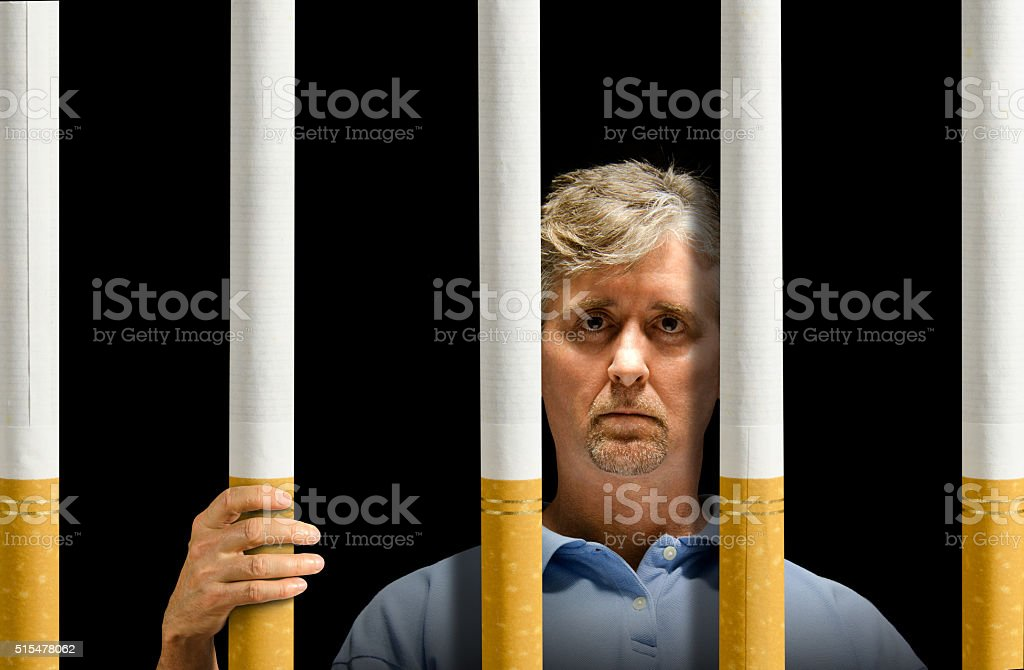 Trapped by cigarettes nicotine addiction prison stock photo