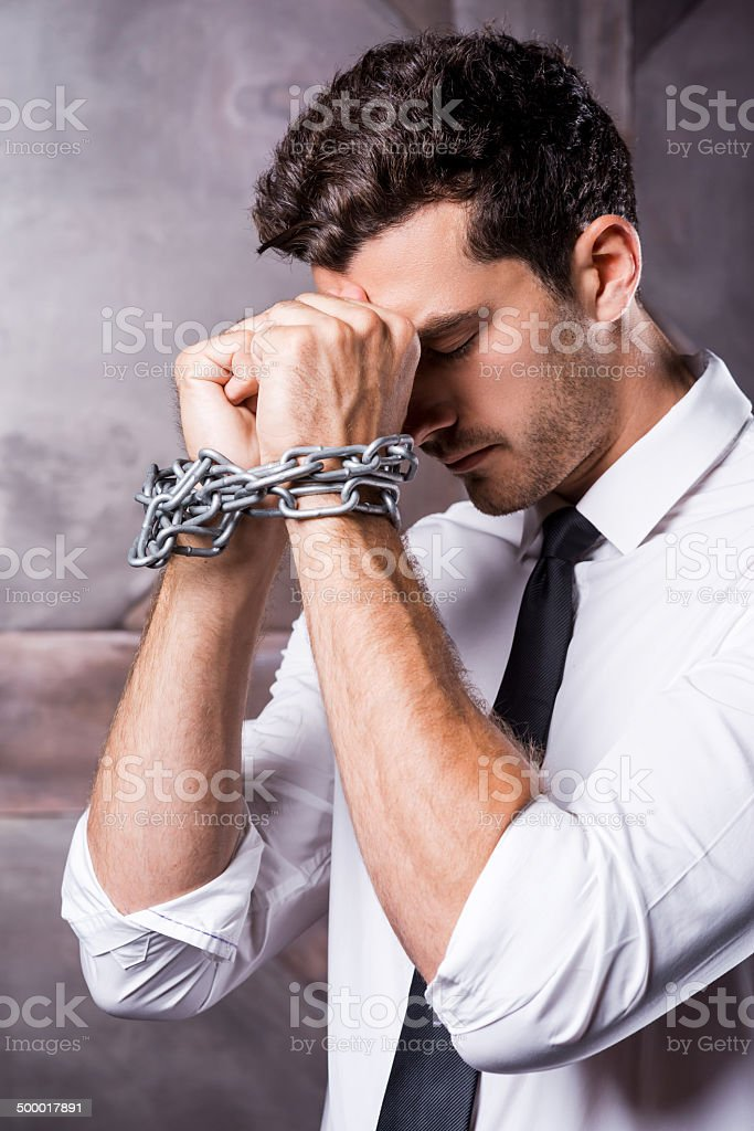 Trapped in chains. stock photo