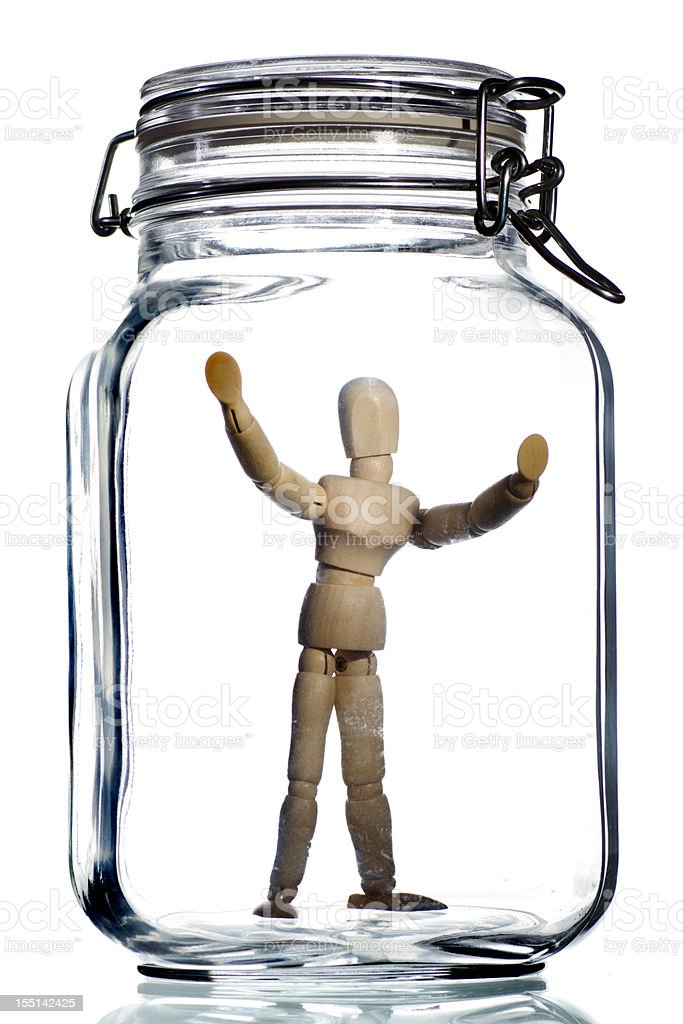 trapped in jar stock photo