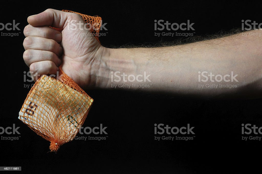 Trapped Money And an Hand royalty-free stock photo