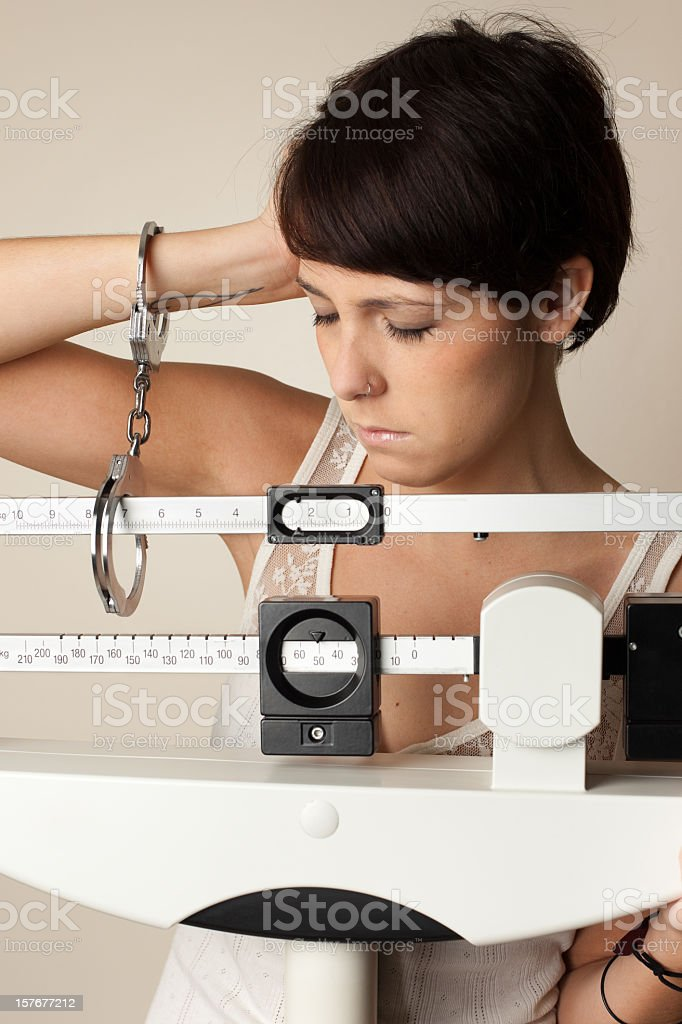 trapped on the scale royalty-free stock photo