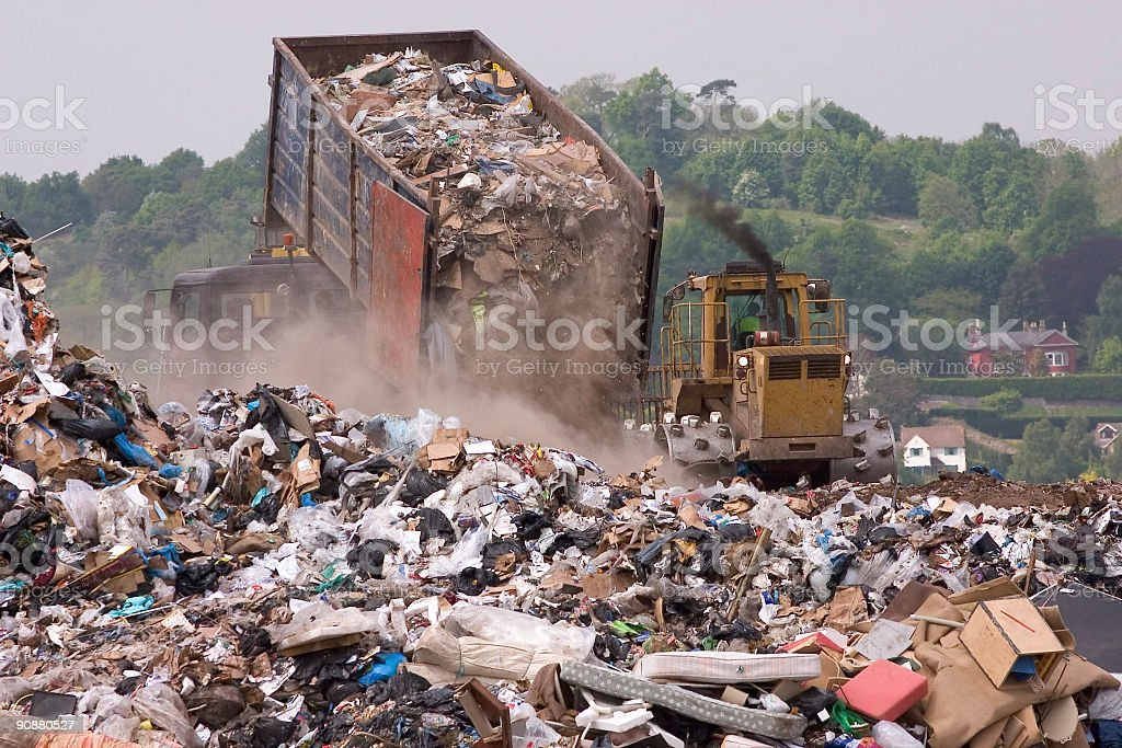 Trash being dumped into a landfill stock photo