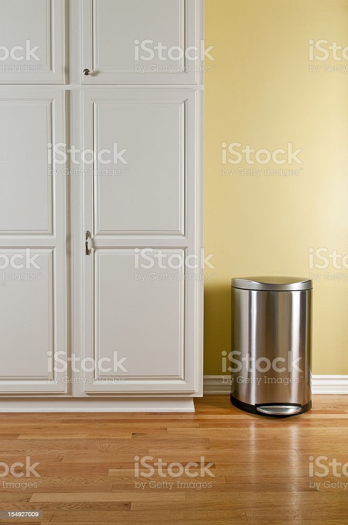 Trash Can and Kitchen Cabinets stock photo