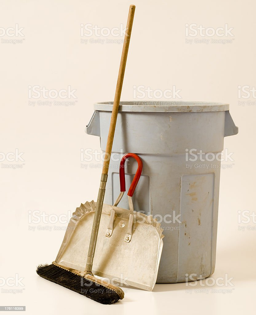 Trash can, broom, and dustpan stock photo