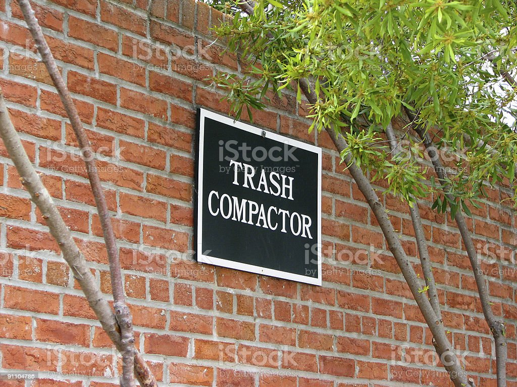 Trash Compactor Sign stock photo
