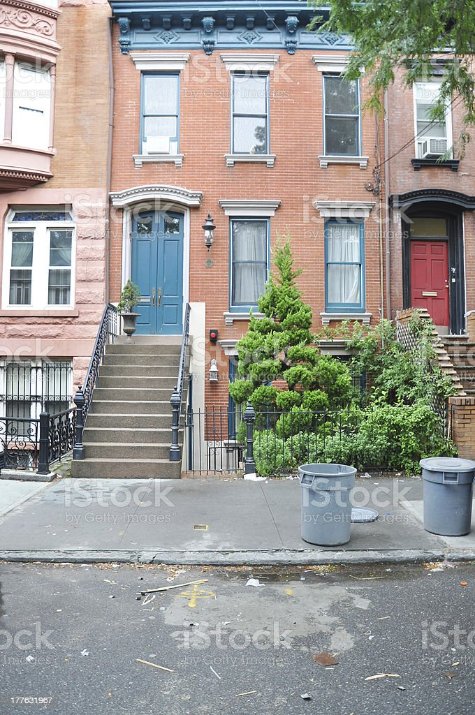 Trash Container Sidewalk Brownstone Residential Neighborhood royalty-free stock photo