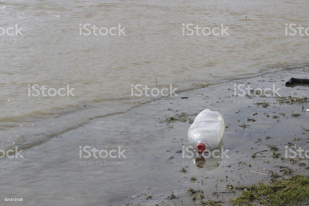 Trash in the river stock photo