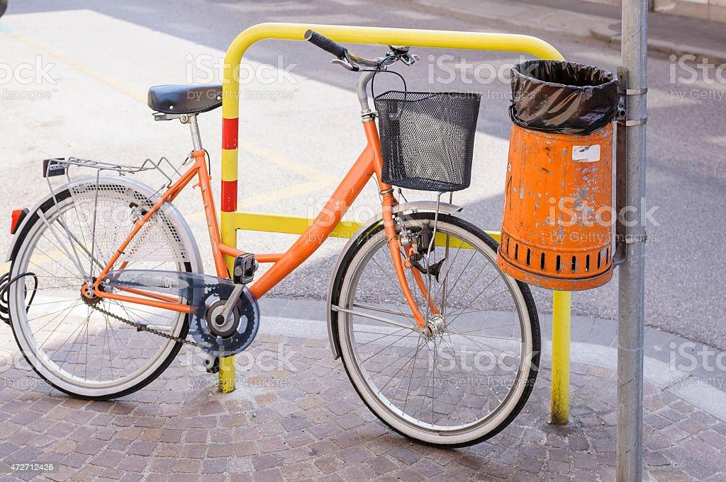 Trash metal orange waste and bicycle stock photo