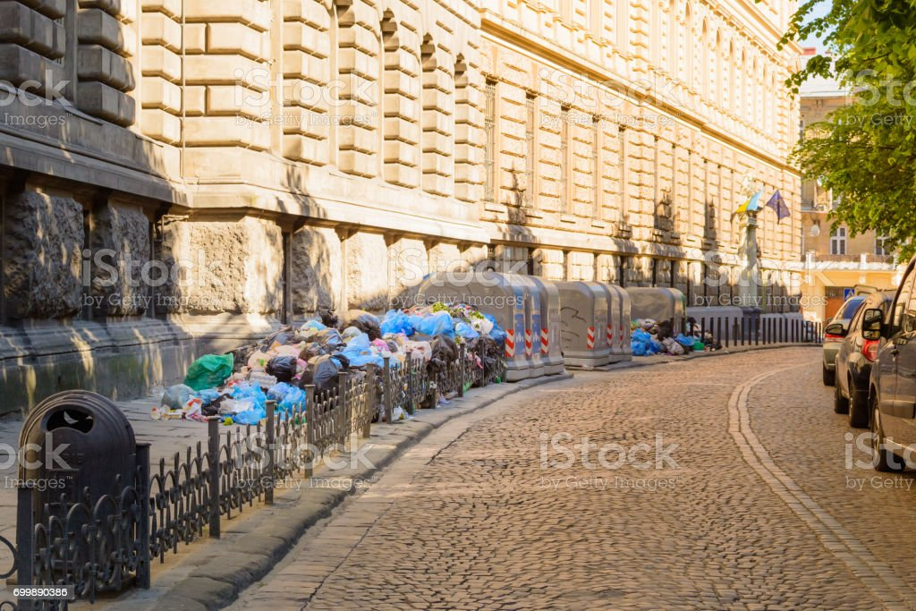 Trash near containers in the streets stock photo
